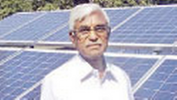 Veerla Prabhakar Rao stands beside the solar panels at his farm land in Velichala | expressphoto
