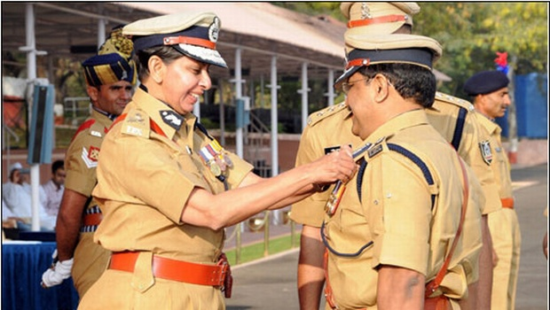 National Police Academy director Aruna M Bahuguna presenting a medal to deputy director NRK Reddy in Hyderabad on Monday | EXPRESS PHOTO