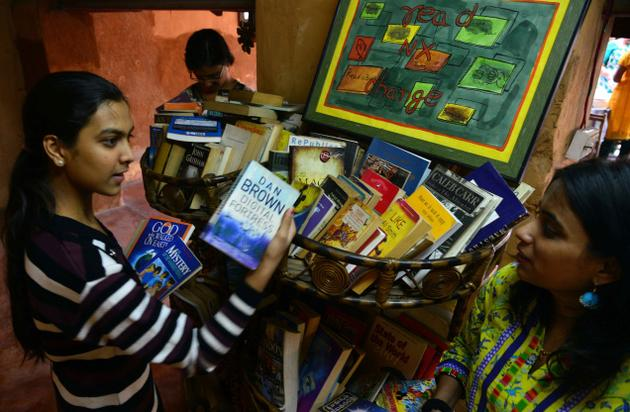 Book lovers sift through the collection at Our Sacred Space. Photo: G.Ramakrishna