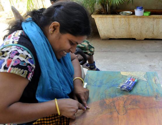 OF WOOD AND COLOURS Artist Karuna Photo: K. Ramesh Babu / The Hindu