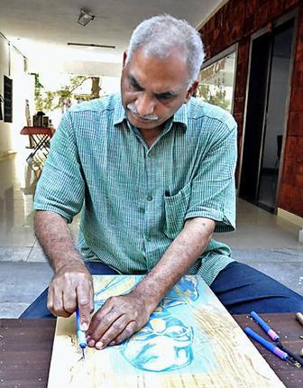 OF WOOD AND COLOURS Professor Vijay Bagodi Photo: K. Ramesh Babu / The Hindu