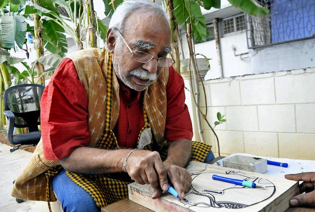 OF WOOD AND COLOURS Artist Thota Vaikuntham Photo: K. Ramesh Babu / The Hindu