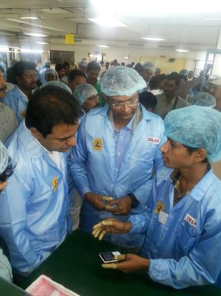 Telangana IT Minister K.T. Rama Rao listening to the manufacturing process of Celkon phones at its unit in Medchal in Hyderabad on Friday after formally opening it. / Photo: N. Ravi Kumar / The Hindu