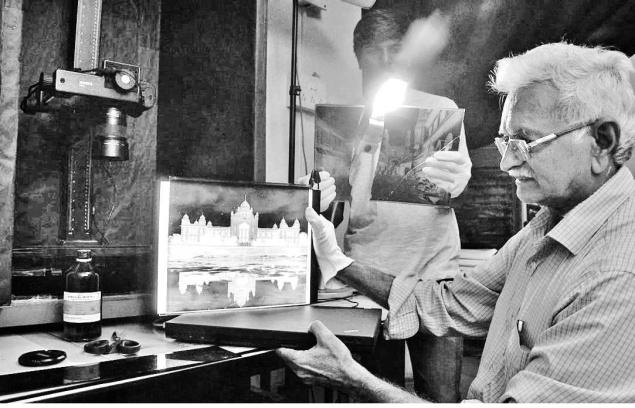 The Telangana State Archaeology Department has taken up digitisation of negatives of old photographs in Hyderabad. Senior photographer of the department Narsing Rao engaged in the process.— Photo: Nagara Gopal