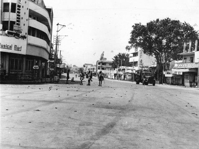 Security personnel patrolling on Jawaharlal Nehru Road (Siddiamber Bazaar) during a 33-hour curfew in Hyderabad on June 05, 1969. Photo: The Hindu Archives/M.A. Rahim